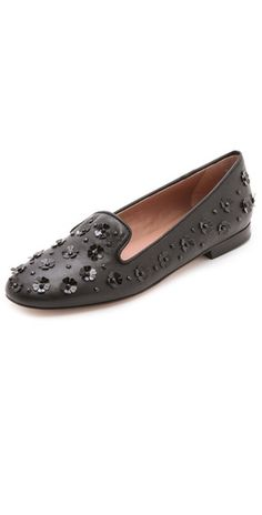 395.00 Flower sequins add a playful element to smooth leather RED Valentino loafers, styled with a gently tapered, rounded toe. Stacked heel and leather sole. Leather: Calfskin