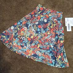 LuLaRoe Girls' Azure Skirt NWT NWT Too big for my little one. Girls' size 4. LuLaRoe Skirts