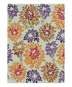 Cover a hardwood floor with this bright, floral design. Not only will this rug protect the wood from dings and scratches, it's a treat for feet with its hand-tufted cut-and-loop pile, too.
