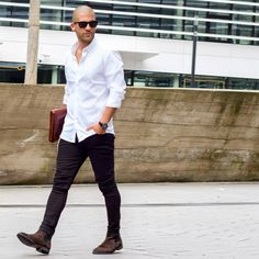 man wearing jeans and white shirt