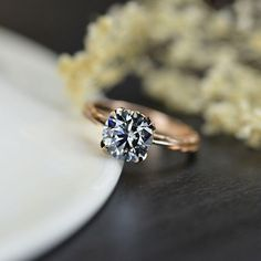This pieces has been inspired by natural forms. 2.0 Carat Gray Color Moissanite Center Stone ( Round 8 mm, I2-Clarity, Ex-Cut, Ex-Polish, VG-Symmetry) in 14K White Gold. Please remember that you can customize this ring in any way you would like in 3D. As well please remember it takes up to 14 days to make and ship this item. Engagement Rings Under 1000, Grey Diamond Engagement Ring, Colored Engagement Rings, Diamond Promise Rings, Pink Gold Rings, Rose Gold, 19 Days, Moissanite Diamonds, Eternity Ring