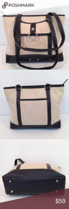 Womens Stone Mountain Tote Canvas Faux Leather Womens Stone Mountain Tote Canvas Faux Leather Laptop Case Top Zip Close Strong Canvas with Faux Leather Trim Can carry Laptop, Papers, pens, you name it Measures 13x10x4 with 11 inch strap drop 1 exterior slip pocket 1 exterior magnetic close pocket 1 interior zip pocket 2 interior slip pockets Stone Mountain Accessories Bags Totes