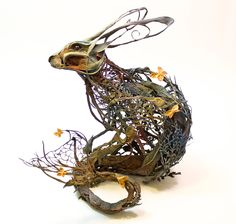 """Natural history surrealist sculpture,"" is what sculptor Ellen Jewett calls her creations which are a mixture of both plants and animals. Her work references many different sources such as medical illustration, anthropology, and stop-motion animation. Rabbit Sculpture, Sculpture Clay, Metal Sculptures, Garden Sculptures, Pottery Sculpture, Sculpture Ideas, Abstract Sculpture, Ellen Jewett, Mystical Animals"