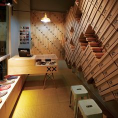 MoVe architects - Bestias XX, Santiago del Chile. Footware store interior covered with stacked shoe boxes