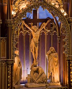 montreal notre dame photos - Google Search  This is the best close up I could find of the Crucifix on the High Altar.