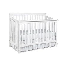 I love the look of a white crib in a brightly colored nursery.