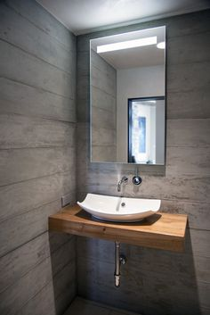 Modern Bathroom: Modern, Organic Materials, Natural Materials, rustic modern, modern bathroom, modern vanity shelf, porcelain vessel sink, wood plank wall, modern vanity mirror, modern fixtures, stone floor, stone tile floor, modern recessed can lights, sliding wood door, ceiling light