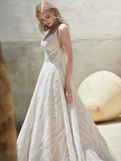Sottero and Midgley - ROXANNE, Considering an enchanted forest for your venue? Consider gowns of the breezy boho persuasion, featuring sheer details, sensual lines, and the perfect pockets.