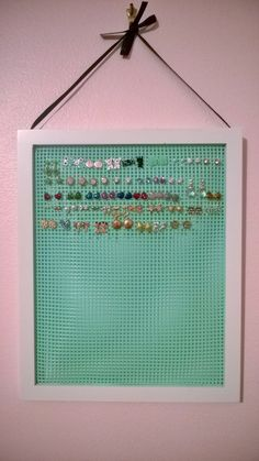 Earring holder!! Start with a wood picture frame painted whatever color you like. Cut sturdy plastic canvas to fit just inside back of frame and glue in place with very hot all-purpose glue gun. Attach ribbon or other hanger to back and display on wall. Terrific for girls room. Save space and keep track of little earrings!