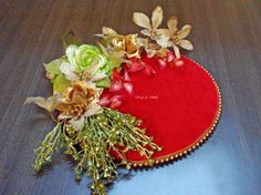 Description - Red Velvet Floral Pearl Platter  Size - Fits upto 1kg (can be customized to a smaller size) Color - Red, Hot Pink, Orange, Royal Blue Price - Rs 700/-   For Inquiries/ Orders/ wholesale / Resale  call us - +91 8976921339  Whatsapp - +91 9820720448  Email - wrapp.a.smile@gmail.com  Inbox us on facebook - https://www.facebook.com/WrapASmile
