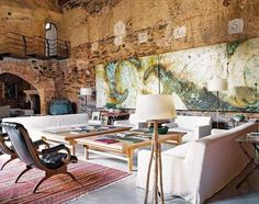 living room furniture at rustic house interior design within a 12th century oil mill in extramadura