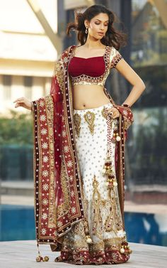 BRIDAL LEHENGA  Product Description  Timeless Traditional White and Red Panetar lehenga in net outlined with badhani borders all over fully detailed with Zardosi work enhanced with Swaroski crytals, Stones and sequins. The Rouched effect on the Short Choli adds a modern twist to this very Traditional Look.