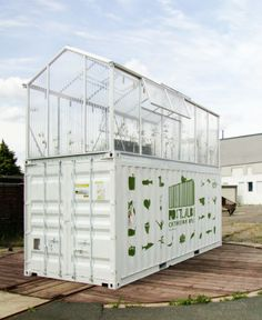 Shipping Container Greenhouse~ Inside each greenhouse is a hydroponic watering system and a metal staircase to the upper level. On the lower level, a fish pond and cleaning tank make it possible to fertilize and recycle water. Upstairs, vegetables and herbs flourish in full sun, protected by the greenhouse roof from the effects of urban air pollution.