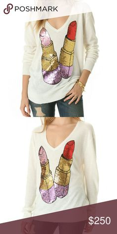 NWOT Wildfox Lipstick Sweater NWOT  - RARE - SOLD OUT - From A Smoke and Pet Free Home  Selling Because V Neck Sweaters Aren't My Style *I Only Negotiate Through The Offer Button*  Description: Sequined lipsticks add a graphic touch as they glitter on the front of an angora-infused V-neck sweater from Wildfox. Ribbed banding trims the edges.  Fabric: Fine knit. 45% viscose/40% nylon/15% angora rabbit hair. Dry clean. Imported, China.  MEASUREMENTS Length: 26in / 66cm, from shoulder Cheaper…