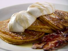 Orange Pumpkin Pancakes with Vanilla Whipped Cream, Cinnamon Maple Syrup and Thick-Cut Bacon recipe from Anne Burrell via Food Network