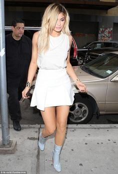 Pretty in white: For lunch, the blonde star worked an off-white short skirt with a matchin...