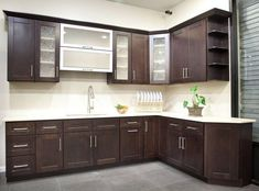 """Open shelving on top right for area where only a 12"""" cabinet fits."""