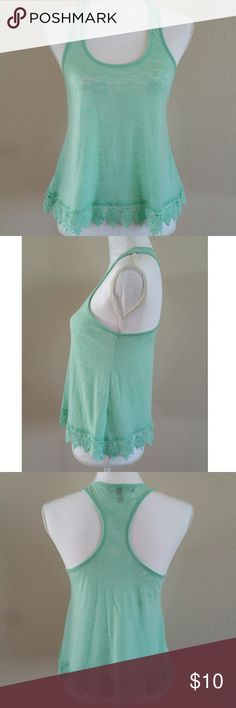 Mint green tank top A small slightly see through mint green tank top with a beautiful lace like design on the bottom. Worn a few times out but is still in great used condition. From a smoke free home. Derek Heart Tops Tank Tops