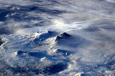 Spotted volcano Kluchevskaya Sopka smoking away on Russia's far east coast this morning – heat has melted snow around top   Credits: ESA/NASA  140A7274
