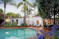 Brentwood - brick pool deck, lush landscaping, spanish tile roof