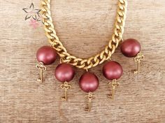 Items similar to Secret Garden, Gold plated brass key charms, Bordeaux acrylic pearls, Brass chain, Christmas Handmade Necklace on Etsy Unique Christmas Gifts, Handmade Christmas, Handmade Jewellery, Handmade Necklaces, Brass Chain, Bordeaux, Jewelry Collection, Charms, Jewelry Accessories