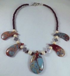 don't like the shape of these particular stones, but I love the color!  Code by EarthMotherJewels on Etsy, $62.00