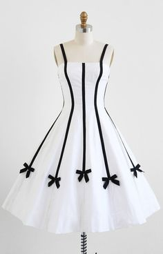 1950's delightful white dress with black bows.