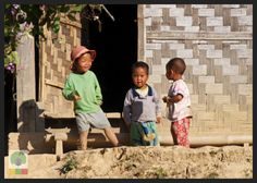 Smiles of Myanmar. And kids, they are always happy and you realize by seeing them that happiness doesn't mean having everything. They are here in this bamboo hut at Inle Lake playing or… planning their next move! ;)
