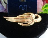 15% off w/Coupon 21417 Vintage Givenchy NWT Original Gold Plated Swirl Pin.This brooch is new and unworn - still  has the Tags. Free Shipping to the US. CCCsVintageJewelry.com