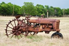 An old metal wheeled tractor.  Prints can be purchased at Fine Art America.
