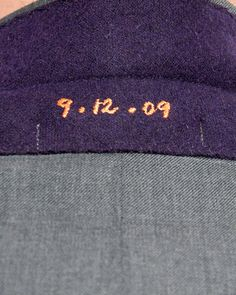 This groom's suit had a hidden surprise under the collar -- the couple's wedding date embroidered in orange