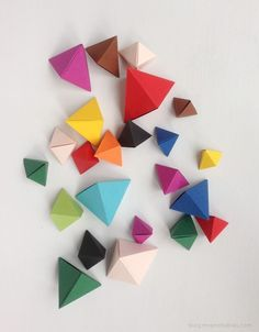 DIY origami bipyramid tutorial -- this took me a lot of trial and error to get it right. The instructions are decent, but I simply couldn't get it to roll into the pyramid for a long time. But once you do it once, it gets much easier each time.