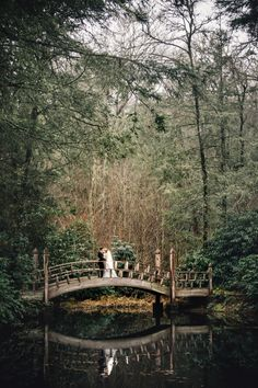 Bride and groom on a beautiful wooden bridge. Winter wedding at The Farm at Old Edwards Inn and Spa in Highlands, NC. Image by Vue Photography.