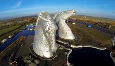 By Glasgow (Falkirk), Scotland-based artist Andy Scott... the two largest equine sculptures in the world / arial view
