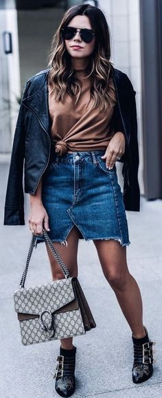how to wear a denim skirt : leather jacket   bag   boots   top