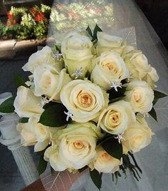 White roses accented with starfish rhinestones.