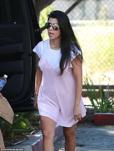 Back to the future:Kourtney stepped out in a Nineties-inspired look wearing a baby pink crushed velvet slip dress over a white T-shirt