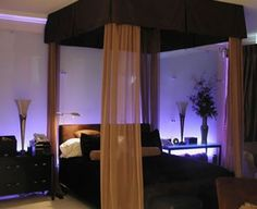 Brown bedroom purple lighting