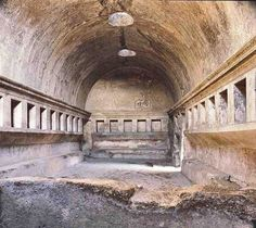 An apodyterium (changing room) with niches for the clothes in the Stabian Baths or Terme Stabiane, Pompeii.