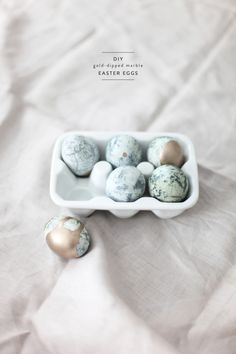 Maybe our favorite eggs to date: Marble Gold-Dipped Easter Eggs with a how-to right here: http://www.stylemepretty.com/living/2013/03/28/diy-gold-dipped-marble-eggs/ Photography and Styling by Style Me Pretty Living http://stylemepretty.com/living    #Easter #EasterEggs