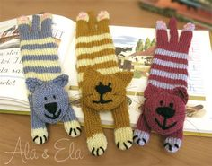 Knitted Bookmarks - they look a bit thick to be a useful bookmark but one would look nice on a bookshelf or a mantlepiece.