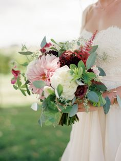 Dahlia and greenery wedding bouquet: http://www.stylemepretty.com/2017/05/26/midwestern-vineyard-wedding-with-rustic-chic-style/ Photography: Kate Weinstein - http://www.kateweinsteinphoto.com/