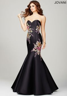 Radiant strapless mermaid dress features multicolored floral appliques and a sweetheart neckline