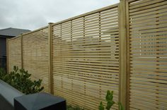 Would need to be more widely spaced and panels fit to size.   Google Image Result for http://www.mmfencing.co.nz/uploads/93431/images/254861/DSC_0343.jpg