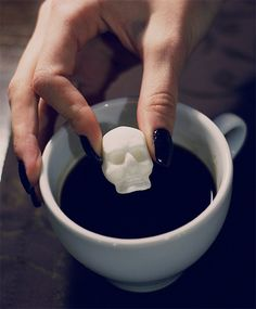 Creative sugar packaged to look like three-dimensional skulls and bones will add some excitement to your morning coffee.