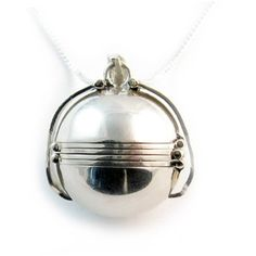 Our Marissa ball locket is a beautiful and clever way to your loved ones close to your heart.    The locket is an elegant ball shape that opens up to reveal six of your loved ones.    The pictures can be removed and updated with new pictures.    To make things easier for you we can print and place the photos in the locket if you prefer.    Please note that these photos will not be waterproof.    We can also engrave the reverse side of 3 of the photo sides