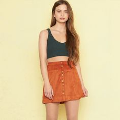 Faux suede skirt Nwt! A little loose on my waist, I like my clothes to fit super tight. Never been worn. Still has tags. No flaws. Color: buffalo rust. Size: small. Super cute and trendy. Material: 90% polyester 10% spandex. Isn't too short Garage Skirts Mini