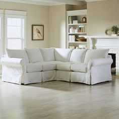 Gather the family for movie night in the den or curl up with your latest read on this lovely sectional, perfect topped with pattered pillows and cozy throws.