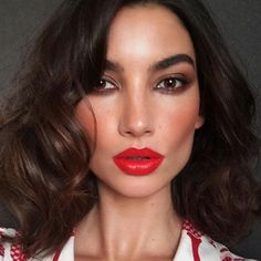 You don't need to pile on a ton of glitz and glitter to conjure up festive vibes. That's why we love @LilyAldridge's flushed red cheeks and candied apple lipstick—it's a fresh approach to holiday beauty. #Regram from makeup artist @HungVanngo. #style #L4L #model