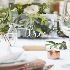 Place acrylic sheets within the wooden holders provided to stand the numbers up. Top your tables with these simple acrylic table numbers. Table Number Stands, Table Set Up, A Table, Cork Table, Botanical Wedding Theme, Wedding Signs, Wedding Day, Wedding Shop, Diy Wedding